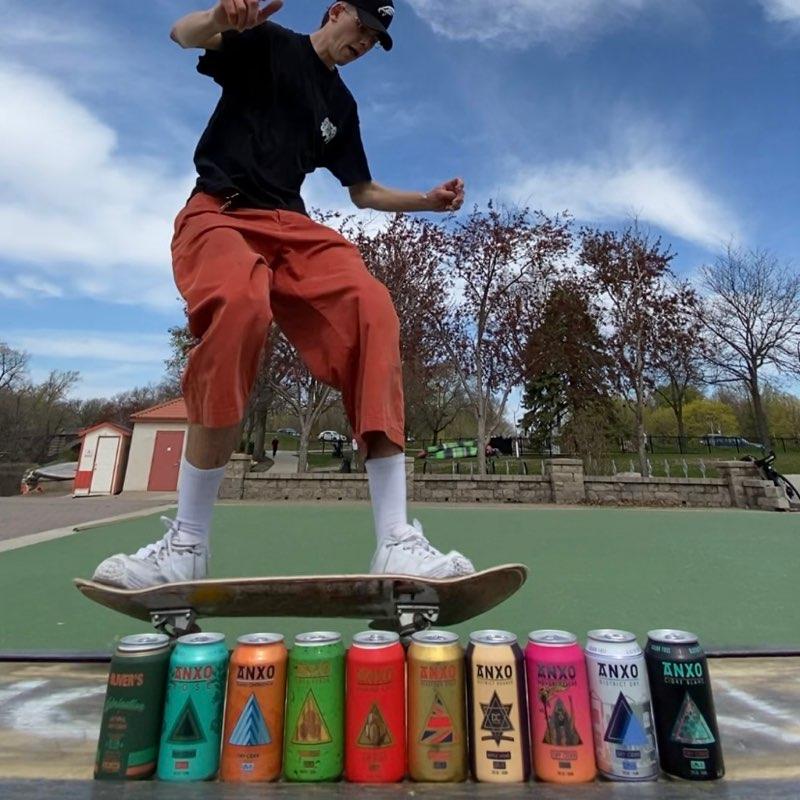 Skater jumping an ANXO can