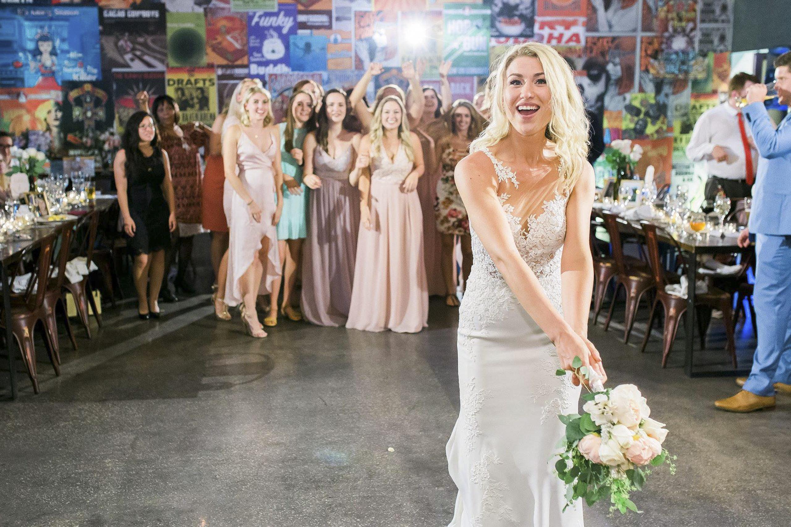 Bride throwing flowers
